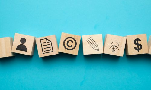 copyright concept with icons wooden blocks min